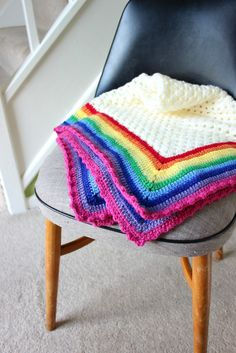 I wanted to call this Easy Granny and her Rainbow Edge but I thought it sounded a bit saucy. It's now just a Rainbow Edged Granny Square. A very traditional sort of crochet blanket but one th…