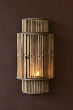 Lifestyle image of the Bamboo Curved Wall Lantern with a candle lit inside it on briarwood painted wall background Types Of Lighting, Unique Lighting, Lighting Design, Indoor Wall Lights, Ceiling Lights, Wall Mounted Lamps, Bamboo Wall, Curved Walls, Wall Lantern