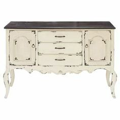 At home in your entryway or stowing linens in the dining room, this handmade wood cabinet brims with country-chic appeal.