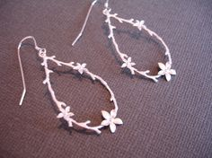 Sale Silver Flower Earrings Hoop Style Earrings. $19.00, via Etsy.