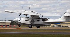 A WWII PBY Catalina flying boat takes off at Farnborough