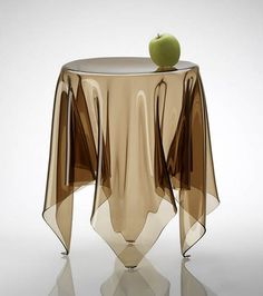 Illusion is a handmade side table of 3 mm acrylic. All Illusion tables are handmade, individual and unique.The design gives the impression of a table cloth on a round table. However, the object uses the structural strength of the folded material to create a magical and surprising experience – an illusion. (Designer: Rafa Garcia)