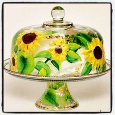 Sunflower Hand Painted Cake Dome   The sunflower design on this cake dome brings a smile to my face every time I look at it. The memories it evokes are of late summer. Bring that feeling of warm sunshine on your skin to the dessert table with this cake dome. #sunflower #cakedome #handpainted