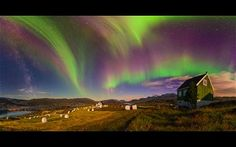 The high-speed particles then crash into Earth's upper atmosphere over the polar regions, causing the atmosphere to emit a ghostly, multicolored glow.