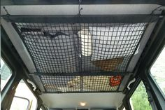 Creative RV storage idea - Ceiling cargo net above kids bunks, great for stuffed animals, bedding, etc.