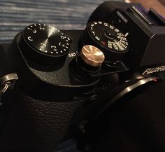Created for me by my good friend Mike, the fine jewellery craftsman. 14k Rose Gold Soft Release Button for my Fujifilm X-T2. Blinged out!