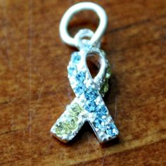 DownSyndromeAwareness Jewelry makes a great keepsake gift for someone special touched by Down syndrome. Order a gift today with this sterling silver Autism Awareness Ribbon during Downs Syndrome Awareness Month or for a Mother's Day gift, birthday,Special Needs Teacher Giftor holiday.