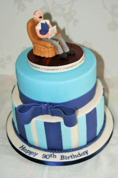 Blue and ivory birthday cake with handmade model