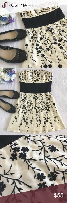 🆕WHBM strapless embroidered floral silk dress Lovely and classic embroidered silk cocktail dress from White House Black Market. Boning in bust and sides gives shape with a zip closure at the back. A pleated black band fits neatly under the bust. Perfect for prom, wedding, bridesmaids, graduation, Easter, or any other special event you can think of. Excellent condition. Size 0 White House Black Market Dresses Mini