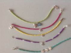 Homemade seed bead bracelets with charms