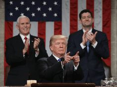 US President Donald Trump delivers the State of the Union address as US Vice President Mike Pence (L) and Speaker of the House US Rep. Paul Ryan (R-WI) (R) clap in the chamber of the US House of Representatives in Washington, DC, on January 30, 2018. / AFP PHOTO / POOL / Win McNamee (Photo credit should read WIN MCNAMEE/AFP/Getty Images)