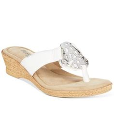 Tuscany by Easy Street Rossano Thong Wedge Sandals  $60.00 Casual yet sophisticated, these Rossano sandals from Tuscany by Easy Street feature a shining metallic hardware detail and wedge heel.