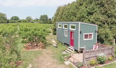 Fruit Farm's Charming Tiny House Is Furnished With Vintage, Thrifted Decor Tiny Houses For Sale, Tiny House On Wheels, Farm Date, Tiny House Talk, Farm Images, Small Sink, Floating Staircase, Christmas Tree Farm, Tiny House Movement