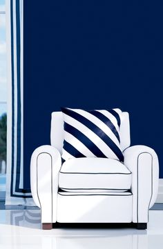 Bordered curtain, piped chair and striped pillow - three crisp, tailored takes on blue and white.