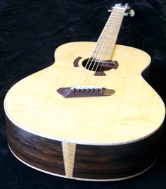 Short multiscale, medium-bodied acoustic in flame redwood and padauk. Acoustic Guitars, Cool Guitar, Music Instruments, Medium, Amazing, Guitar Building, Musical Instruments, Acoustic Guitar, Medium-length Hairstyle