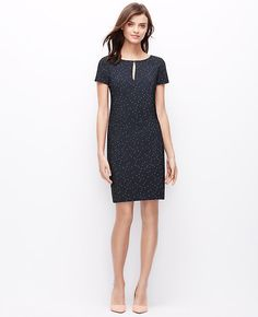 """Done in richly textured dot jacquard, this springtime charmer tops our best-dressed list this season. Jewel neck. Short sleeves. Front keyhole with hook-and-eye closure. Hidden back zipper with hook-and-eye closure. Lined body, unlined sleeves. 18 1/2"""" from natural waist."""