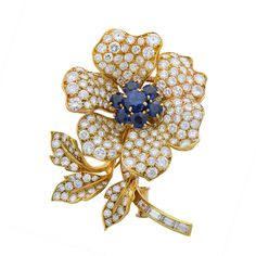 Sapphire and diamond brooch in 18 karat yellow gold by Boucheron, circa 1970s. Signed Boucheron Paris and numbered on the reverse.