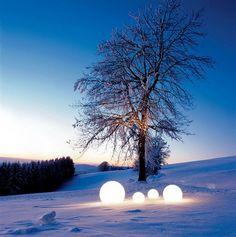 Lighted balls look light glowing snow balls...