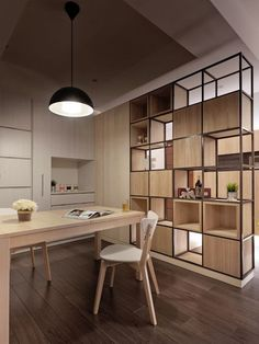 In an open plan space that is short on floor space, it's always practical to look a pieces that serve more than one function. A room divider, for example, can also serve as decorative shelving, or with one side closed off for practical storage.