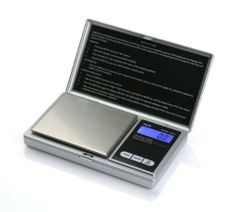American Weigh Signature Series Silver AWS-1KG Digital Pocket Scale, 1000 by 0.1 G by American Weigh. $8.99. Flip-open lid protects the delicate weighing surface. Backed by a powerful 10 year warranty. The backlit LCD display helps make the numbers viewable and easy to read. Weighs up to 1000 grams in 0.1 gram increments. Powered by 2 AAA batteries (included). The AMW Series is a great durable and compact pocket scale for those who are seeking the on the go high-tech portable sc...