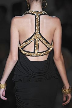 Cut a tiny t-shirt into this design and decorate it with buttons, beads, studs or whatever........