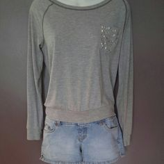 Box Bottom Sweatshirt (M) Glo Denim Shorts (5) Really cute brand new looking box bottom sweatshirt, lightweight t-shirt material, crystal detailed pocket. Remember, gray goes with everything! Jolt brand, size medium but looks more like a small, perfect to wear lounging around the house or running around town. Cute GLO lightwash button denim shorts, size5. A perfect outfit for a perfect summer! Jolt/Glo Other Tees - Long Sleeve