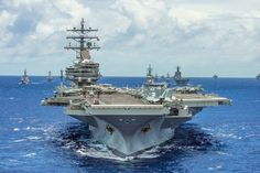 The aircraft carrier USS Ronald Reagan leads a formation of 42 ships and submarines from 15 international partner nations during Rim of the Pacific (RIMPAC) 2014. RIMPAC is the world's largest...