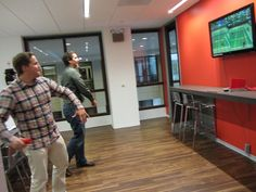 Some Of Our Gogo Employees Taking A Break To Play Wii Tennis In Room