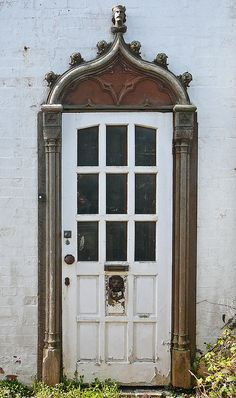 Falmouth, Cornwall, England  I can see adding an interesting door and the details to a plain old brick or cinder block out building.