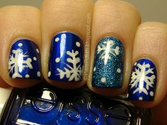 Holiday nails - blue with snowflakes and glitter accent nail
