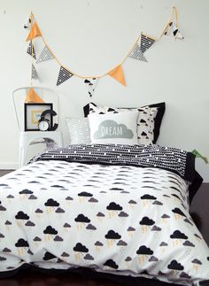The quilt cover is reversible with our exclusive Stormy cloud print featuring the clouds and lightning bolts on the front and the black raindrop