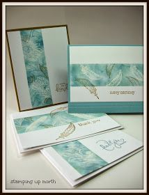 handmade notecard set fromstamping up north: Emboss resist with Fine Feathers stamps ... wide band masked off for white embossing with sponged blues and then some overstamping in brown ... beautiful look!! ... Stampin' Up!