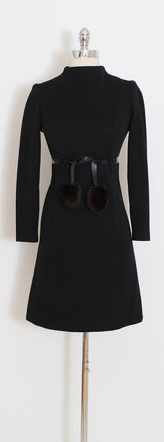 ➳ vintage 1960s dress  * black wool * leather belt with rabbit fur pom poms * back zipper  condition | excellent  fits like small  length 35 bodice 15 bust 34-36 waist 30 hips 36 sleeves 21 shoulders 14  ➳ shop http://www.etsy.com/shop/millstreetvintage?ref=si_shop  ➳ shop policies http://www.etsy.com/shop/millstreetvintage/policy  twitter | MillStVintage facebook | millstreetvintage instagram | millstreetvintage  5844/1701
