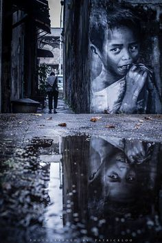 Mural artwork by Julia Volchkova #figure #realistic #street #art