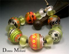 Lime & Coconut, lampwork beads by me, in my etsy.  Click me!