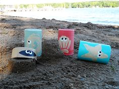 Great summer craft! Painted cans with sea creatures! They would be great for a summer party turning them into luminaries!