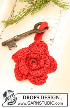 """Crochet DROPS Christmas flower for key ring in """"Cotton Viscose"""". Freebie and lovely. Thanks so for share xox"""