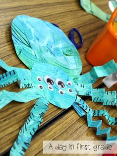 Spiders inspired by Eric Carle's A Very Busy Spider.  Painted with only sponges and only 2 colors.  Love the crinkle legs! (A day in first grade)