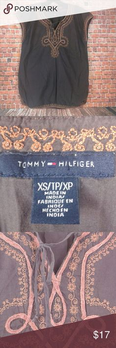 Tommy Hilfiger Brown Embroidered Boho Top Brown embroidered boho top size extra small. The neck line has a cute tie detail. Excellent used condition. 100% cotton. No holes, stains, or flaws! Comes from a smoke and pet free home! Tommy Hilfiger Tops