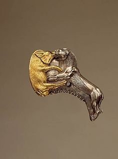 A Magnificent and Highly Important Gold and Silver Bactrian Ceremonial Axe by Ancient Art, via Flickr
