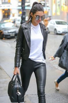 Kendall's spotted walking in SoHo wearing a Barbara Bui jacket, Balenciaga leather pants and a Nasty Gal tee.