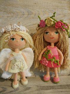 Doll. Angel. Toy handmade. Amigurumi. Doll with flowers.