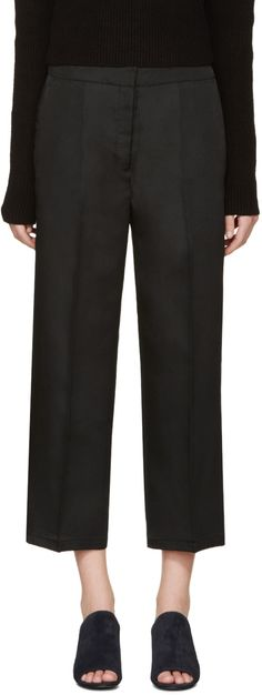 Straight-leg woven trousers in black. Cropped fit. Four-pocket styling. Zip-fly. Unlined. Tonal stitching.