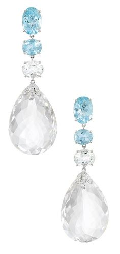 Aquamarine, Rock Crystal and Diamond Pendant-Earclips 18 kt., topped by a line of 6 oval aquamarines approximately 26.00 cts., suspending 2 rock crystal briolettes approximately 92.35 cts., accented by 20 small round diamonds.