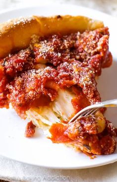 How to Make Chicago-Style Deep Dish Pizza on sallysbakingaddiction.com-- complete with step-by-step photos, tricks, and tips!