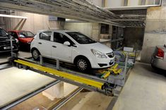 Wohr Parking offers the ideal solution for Automatic Car Parking System in India. Parklift 440 Suitable for indoor installation with pit. Cube Car, Parking Solutions, Automatic Cars, Plate, Car Parking, Robot, Garage, Elevator, Rotary