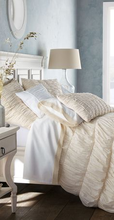 I'm thinking once I upgrade from a full bed to a queen I am going to get a nuetral bedspread and add color with throw pillows and painting my room..