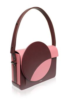 This **Perris Paris** Le Rond Épaule Bag is rendered in calfskin and features a circular oversize color block detailing at the front.