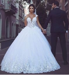 This princess style wedding dress has a large ball gown design. Get custom wedding dresses & replicas of haute couture bridal gowns like this one made to order specific for your body and to your personal preferences from our US dress designs company.
