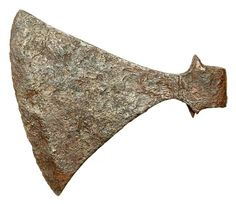 This iron battle axe was found in the Thames at Runnymede in Surrey. The blade is decorated with small dots and its edge has been sharpened. The weapon may have belonged to a Viking invader on board the Danish war fleets which entered the London area in the early 11th century.